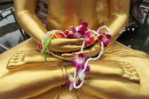 Flower in hand image of buddha in Songkran festival, Thailand. — Stock Photo
