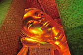 The face of Reclining Buddha statue in Thailand Buddha Temple Wa — ストック写真
