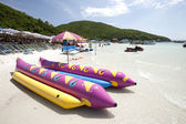 Banana boat lays on a beach — Stock Photo