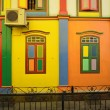 Color shutters and color facade of building in Little India, Sin — Stock Photo