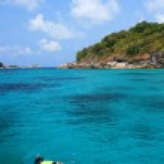 Snorkeling in crystal blue water, Similan island, Andaman Sea, T — Stock Photo #25661193