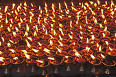 Candle around Boudhanath buddhist stupa in Kathmandu capital of — Stock Photo