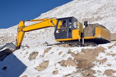 Backhoe loader cleaning snow on the road mountain leh ladakh, In — Stock Photo