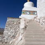 Buddhist monastery (gompa) along river in Ladakh, Jammu & Kashmi — Stock Photo #37940469