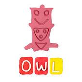 Color children's owl plasticine on a white background — Stock Photo