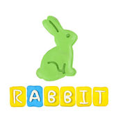 Color children's rabbit plasticine on a white background — Stock Photo