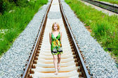 Girl on railroad tracks — Stock Photo