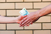 Handshake with money — Stock Photo