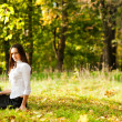 Young girl sitting on the grass — Stock Photo #13670201