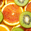Stock Photo: Oranges and kiwi
