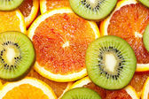 Oranges and kiwi — Stock Photo