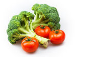 Broccoli and tomatoes isolated on white — Stock Photo