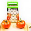 Grater with tomatoes on isolated on white — Stock Photo #21280211