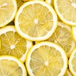 Lemon slices isolated on white — Stock Photo