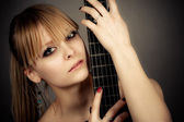 Girl with a guitar fretboard — Stock Photo