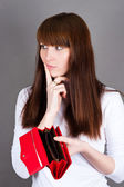 Woman much thought holding a purse — Stock Photo