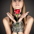 Woman with a rose in hand — Stock Photo #24119073