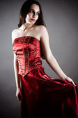 Fashionable woman in a red corset — Stock Photo