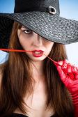 Glamorous woman in hat — Stock Photo