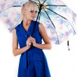 Woman standing with open umbrella — Stock Photo