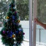 Man opens Christmas window — Stock Photo #36505347