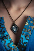 Amulet on a neck — Stock Photo