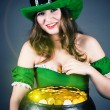 Woman dressed as leprechaun gold hiding — Stock Photo #39305083