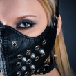 Woman slave in a mask with spikes — Stock Photo #41334303