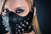 Woman slave in a mask with spikes — Stock Photo