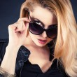 Sexy woman look through sunglasses — Stock Photo #42591797