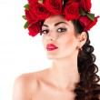 Portrait of beauty fashion model with red roses hairstyle — Stock Photo