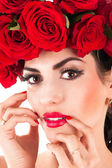 Beauty fashion model with red roses hairstyle — Foto de Stock
