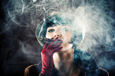 Glamorous woman in retro style with cigar — Stock Photo