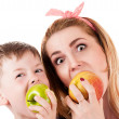 Mother son cheerfully biting apple — Stock Photo #45690415