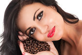 Beautiful brunette with coffee in hand — Stock Photo