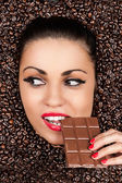 Beautiful woman in a coffee beans with chocolate — Stock Photo