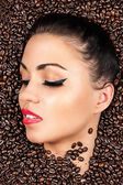 Face with closed eyes in the coffee beans — Stock Photo