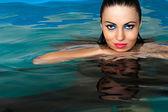 Fashion beautiful woman in the water — Stock Photo