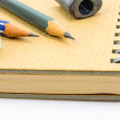 Two Wooden pencil, eraser and sharpener on recycle notebook. — Stock Photo