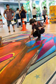 Bangkok - March 3 : An artist (Tony Cuboliquido) during drawing and painting his 3D artwork. — Stock Photo
