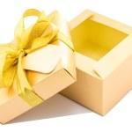 Golden gift box open up on white background. — Stock Photo
