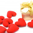 Stock Photo: Golden gift box and red heart on white background.