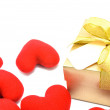 Golden gift box and red heart on white background. — Stock Photo