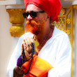 Bangkok - March 17 : Sikh devotee with red turban at Gurdwara Siri Guru Singh Sabha on March 17, 2013 in Bangkok, Thailand. Worldwide there are about 25 million Sikhs. - Stock Photo