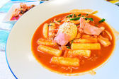 Korean Food, Tukbokki with Boiled egg topping and Kimchi. — Stock Photo