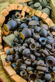 The group of small black clay pots, use for background. — Stock Photo