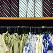 Stock Photo: Colorful collection of men's clothes hanging on a rack and Color