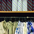 Stock Photo: Colorful collection of men's clothes hanging on rack and Color