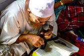 Unidentified Leader Musim senior men reading Quran for ceremony in Graduation of the Quran. — Stock Photo