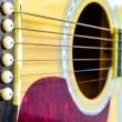 Close up Part of the body of an acoustic guitar. - Stock Photo
